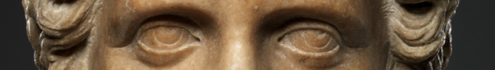 A picture of a stone statue that has been cropped around the eyes